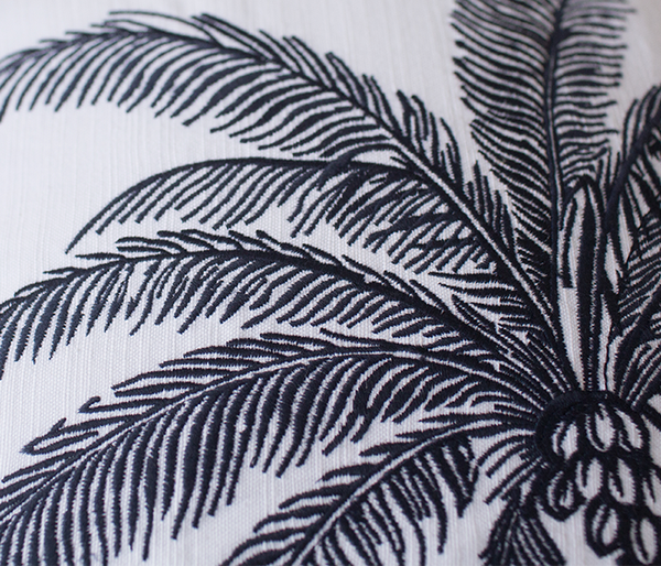 Embroidery detail of the Palm Tree cushion.
