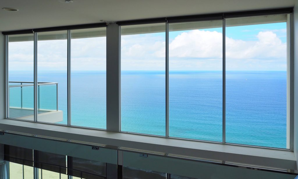 The view from the second floor of our apartment, a huge window wall looking out to the ocean, MAGIC!